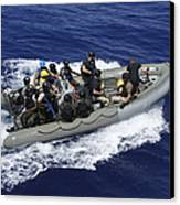A Rigid-hull Inflatable Boat Carrying Canvas Print by Stocktrek Images