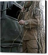 A Scout Observer Applies Camouflage Canvas Print by Stocktrek Images