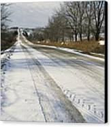 A Snow-covered Road Passes Canvas Print by Joel Sartore