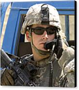 A Soldier Talking Via Radio Canvas Print by Stocktrek Images