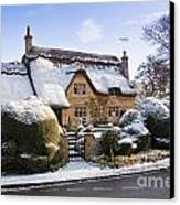 A Thatched Cottage In The Cotswolds  Canvas Print by Andrew  Michael