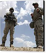 A U.s. Army Soldier Communicates Canvas Print by Stocktrek Images