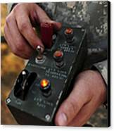 A U.s. Soldier Hits The Button Canvas Print by Stocktrek Images