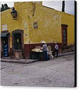 A Vendor Selling Food On A Street Canvas Print by Gina Martin