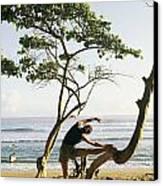 A Woman Stretches On A Beach Canvas Print by Skip Brown