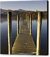 A Wooden Dock Going Into The Lake Canvas Print