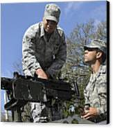 An Airman Instructs A Cadet On How Canvas Print by Stocktrek Images