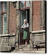 An Elderly Woman Stands At The Door Canvas Print by Cotton Coulson