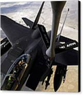 An F-15e Strike Eagle Aircraft Receives Canvas Print by Stocktrek Images