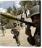 An Iraqi Army Soldier Provides Security Canvas Print by Stocktrek Images