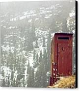 An Outhouse Perches On A Hillside Canvas Print by Rex A. Stucky