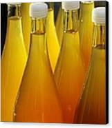 Apple Juice In Bottles Canvas Print by Matthias Hauser