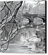 Arch Bridge Over Frozen River In Winter Canvas Print