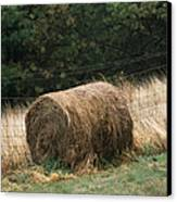 Barbed Wire Fence And Hay Roll Canvas Print by Raymond Gehman