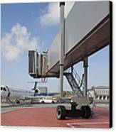Boarding Bridge Leading To A Parked Plane Canvas Print