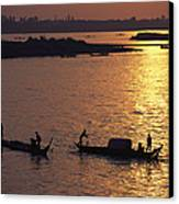 Boats Silhouetted On The Mekong River Canvas Print