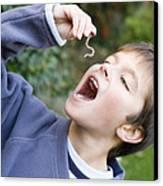 Boy Pretending To Eat An Earthworm Canvas Print