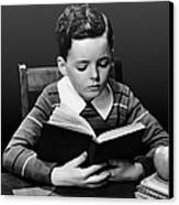 Boy Reading Book At Desk Canvas Print