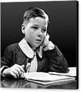 Boy Sitting At Desk W/book Canvas Print