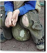 Boy Sitting On Ball - Torn Trousers Canvas Print