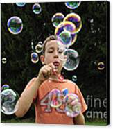 Boy With Colorful Bubbles Canvas Print by Matthias Hauser