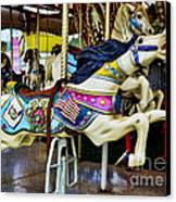 Carousel - Horse - Jumping Canvas Print by Paul Ward