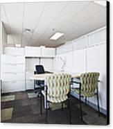 Chairs And Desk In Office Cubicle Canvas Print by Jetta Productions, Inc