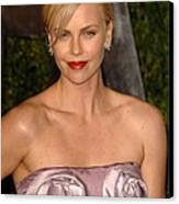 Charlize Theron Wearing A Dior Haute Canvas Print by Everett