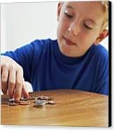 Child With Loose Change Canvas Print by Ian Boddy