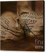 Coffee Beans In Burlap Bags Canvas Print by Susan Candelario