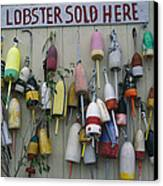 Colorful Lobster Buoys Hang On A New Canvas Print by Stephen St. John