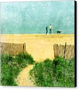 Couple Walking Dog On Beach Canvas Print by Jill Battaglia