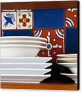 Dishes In Front Of Colorful Tile Canvas Print by Thom Gourley/Flatbread Images, LLC