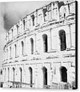 Entrance And Front Of The The Old Roman Colloseum Against Blue Cloudy Sky El Jem Tunisia Canvas Print by Joe Fox