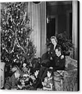 Family With Two Children (6-9) Sitting At Christmas Tree, (b&w) Canvas Print