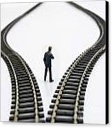 Figurine Between Two Tracks Leading Into Different Directions  Symbolic Image For Making Decisions Canvas Print by Bernard Jaubert