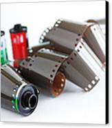 Film And Canisters Canvas Print by Carlos Caetano