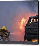 Firefighters Hosing A Burning Car Canvas Print by Duncan Shaw