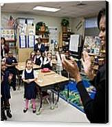 First Lady Michelle Obama Claps Canvas Print by Everett