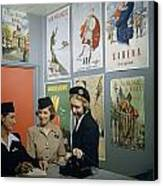Flight Attendants Stand And Talk Canvas Print by B. Anthony Stewart
