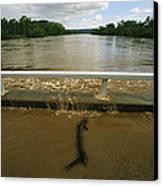 Flood Waters Rise To Meet A Bridge Canvas Print by Randy Olson