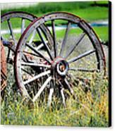 Forgotten Wagon Wheel Canvas Print by Sarai Rachel