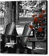Garden Chairs With Red Flowers In A Pot Canvas Print by David Chapman
