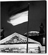 german flag flying fluttering on flagpole outside reichstag building Berlin Germany Canvas Print by Joe Fox