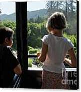 Girl And Boy Looking Out Of Train Window Canvas Print