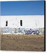 Graffiti On Abandoned Equipment Shed Canvas Print by Paul Edmondson