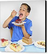 Hungry Boy Eating Lot Of Cake Canvas Print by Matthias Hauser
