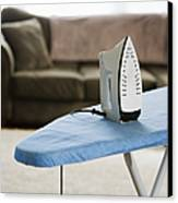 Iron On An Ironing Board Canvas Print by Ben Sandall