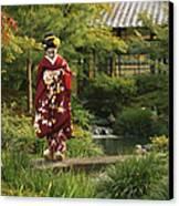 Kimono-clad Geisha In A Park Canvas Print by Justin Guariglia