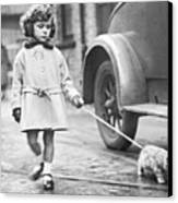 Kitten On Lead Canvas Print by Fox Photos